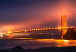 Golden Gate Bridge on a Foggy 4th of July Night