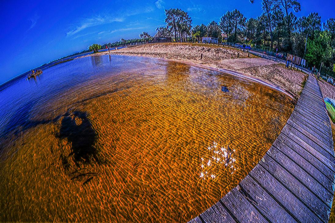 Carcans lake brown bridge by bulgphoto