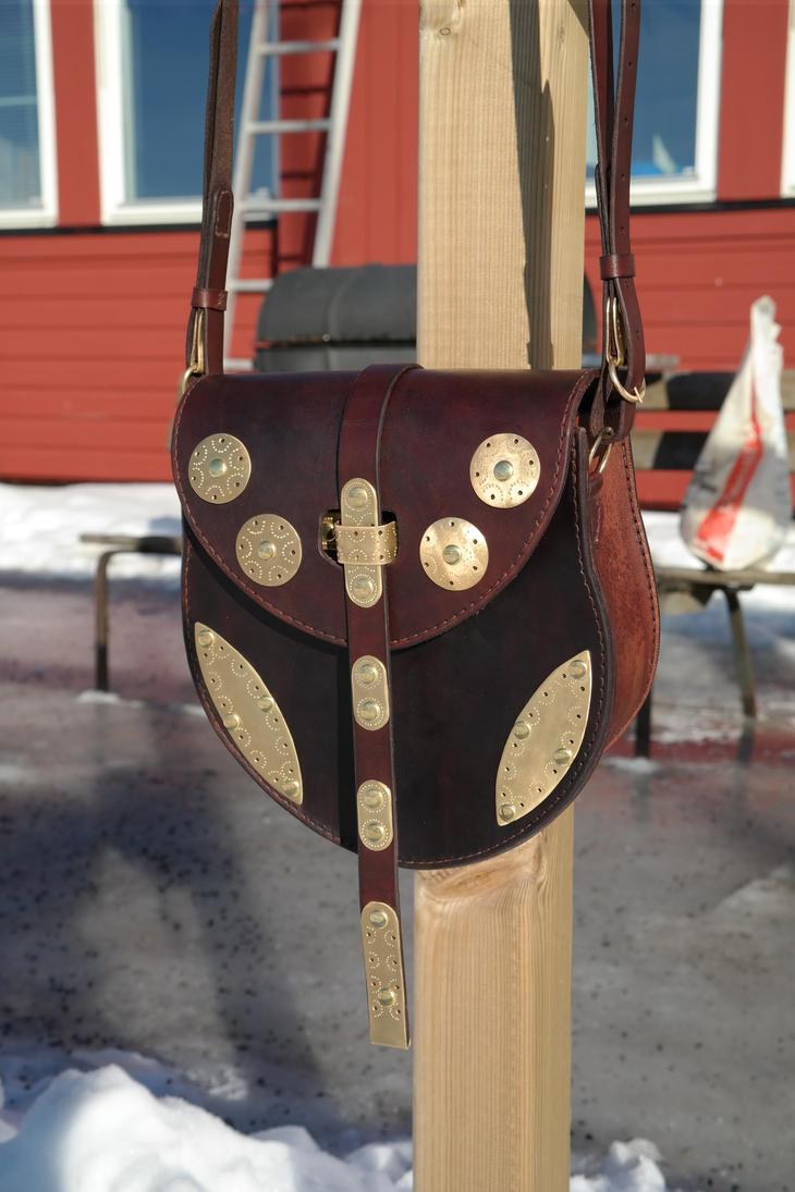 Brass decorated leather shoulder bag by Durnstaros