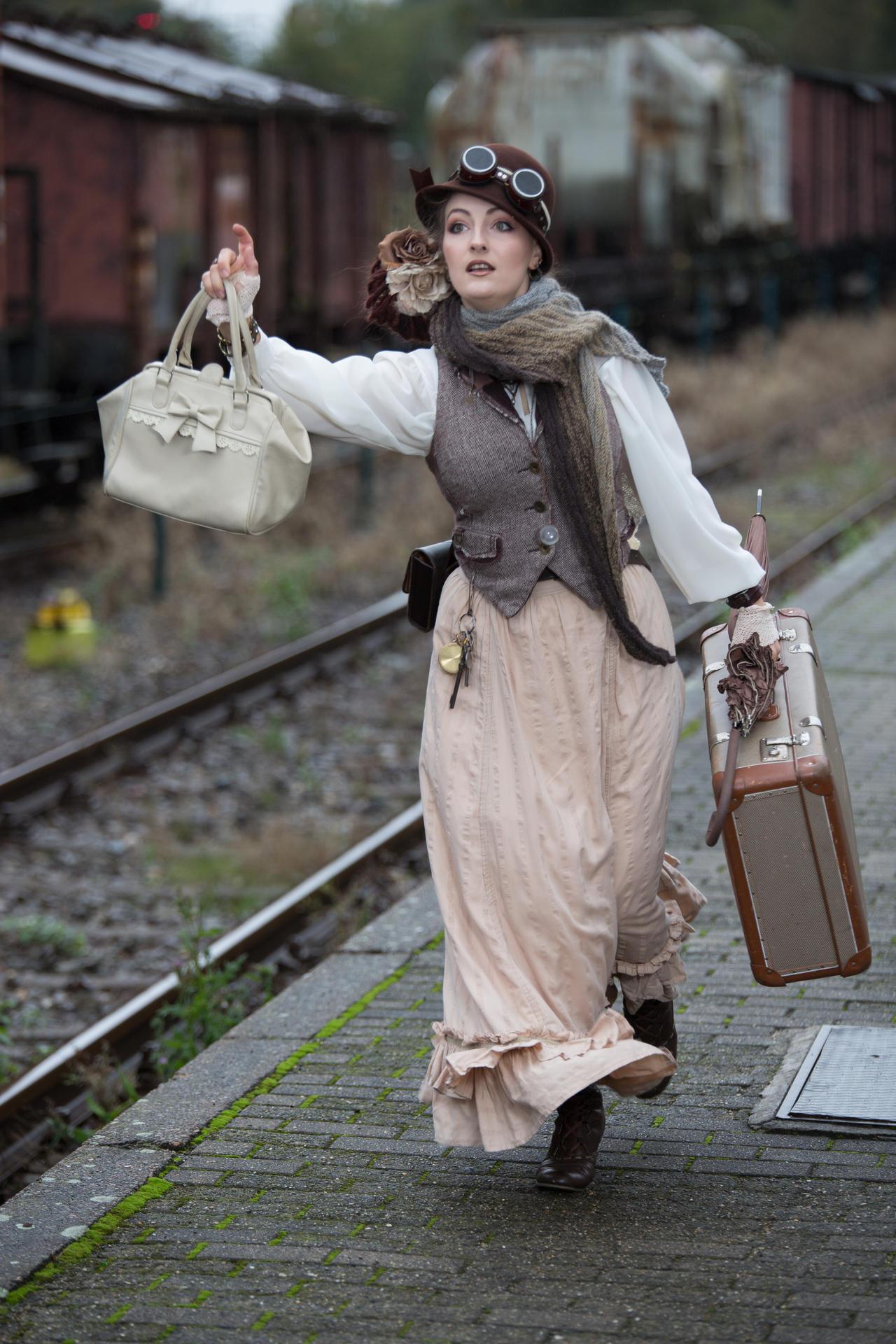 [STOCK] Running Steampunk girl at train station