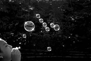 Girl blowing soap bubbles