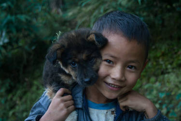 Happiness : a boy from my village and his pet
