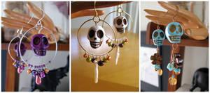 Skull earrings by lily-fox