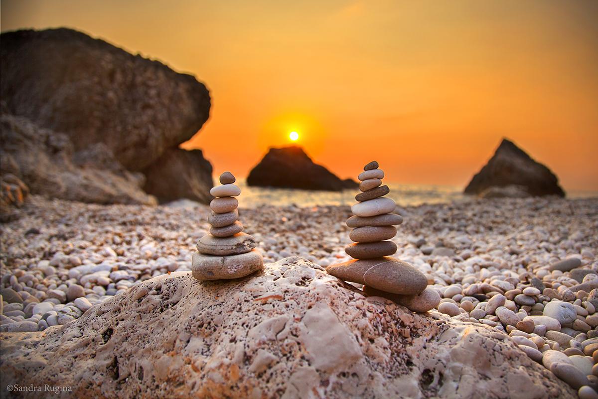 Rock sunset by Behindmyblueeyes