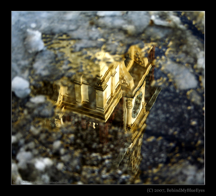 Gold in the puddle by Behindmyblueeyes
