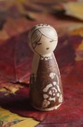 Rosy Scorpio - hand burned wooden doll by aksinia