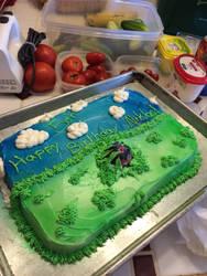 Nina in the grass cake