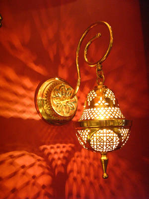 moroccan golden lantern on red by synesthesea