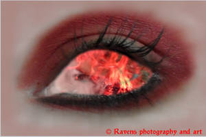 Fire in her eyes by GothicRavenMidnight