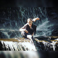 Just sitting in a waterfall by GothicRavenMidnight