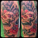 Upper arm skull tattoo