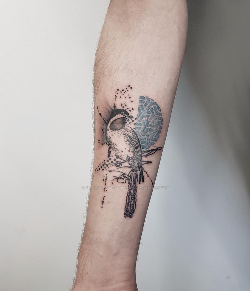 Abstract bird tattoo by SelfmadeTattooBerlin
