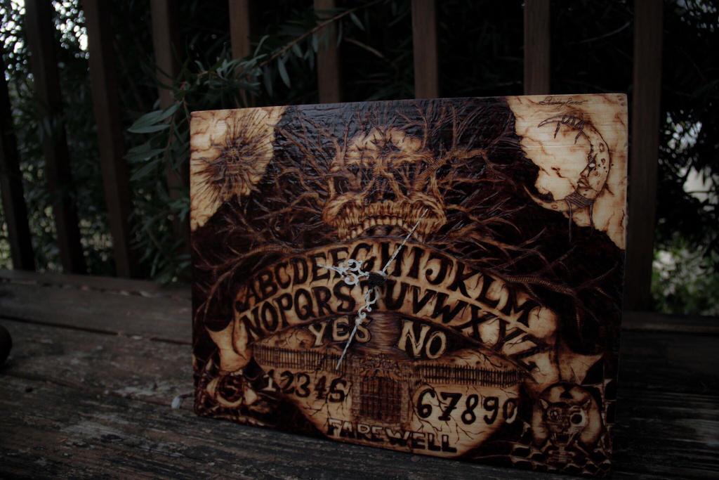 Pyrography Ouija Clock  by trashdoves
