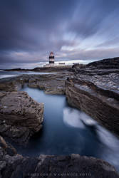Light over lighthouse by Wanowicz