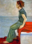 Seated girl on red blanket
