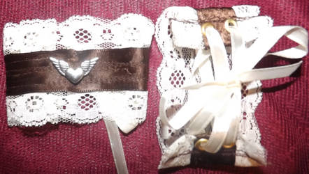 Winged Heart Cuffs by LadyMidnight81