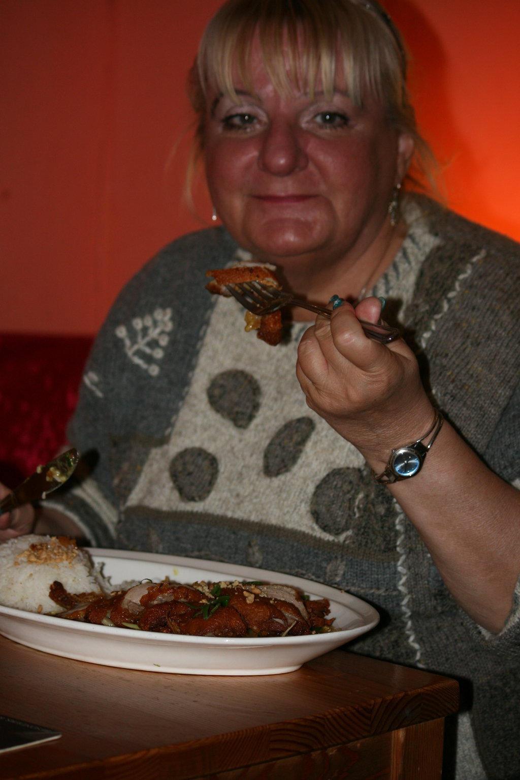 Ingeline eating in restaurant