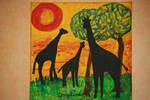 Happy giraffes in sunset