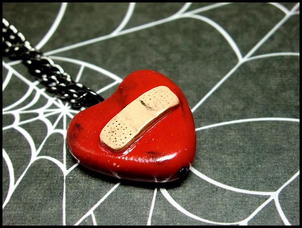 Bandaged Heart Necklace by GrandmaThunderpants