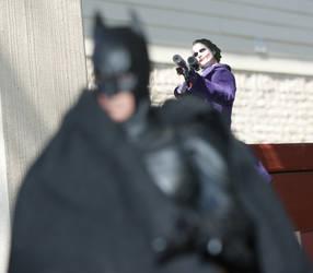 Joker snipes Batman by mrk9sp