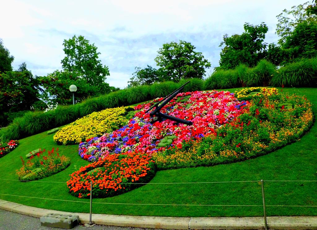 Les horloges de geneve by yellowdove on deviantart for Jardin anglais geneve suisse