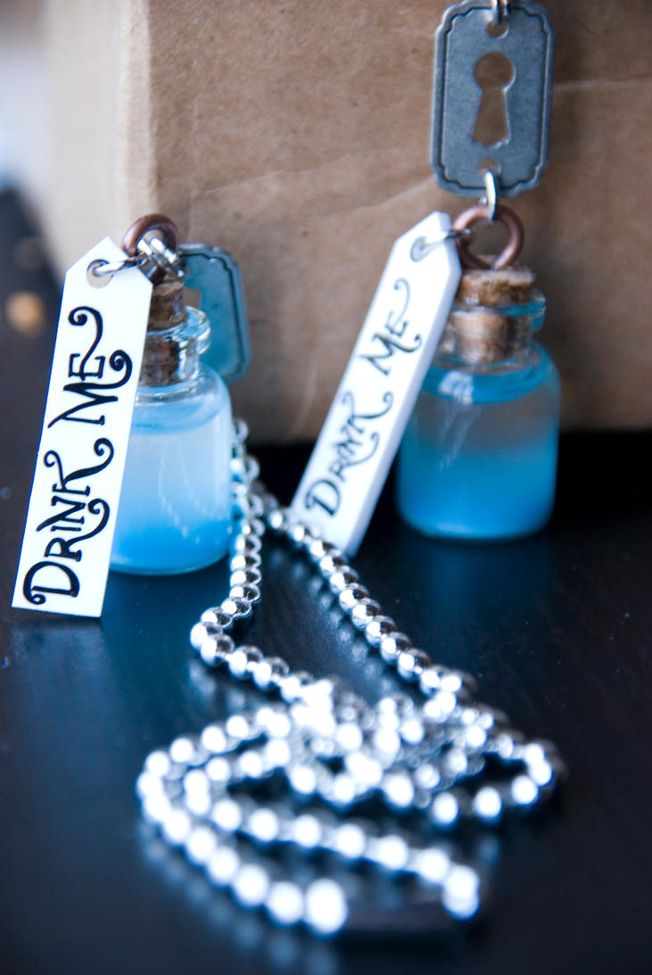 Wonderland Inspired ' Drink Me ' Necklaces by IvrinielsArtNCosplay