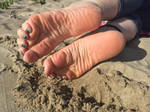 Crinkly Soles in the Sand