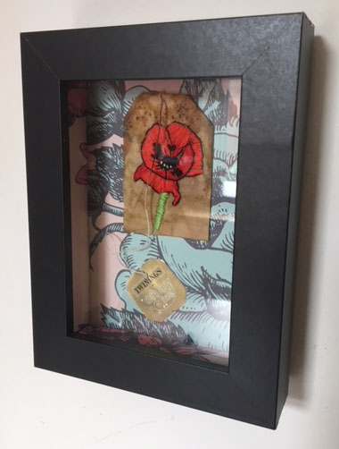 Poppy Embroidered on a Tea Bag. by silverscape