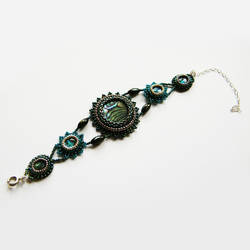 Cascara embroidered bracelet with paua shell