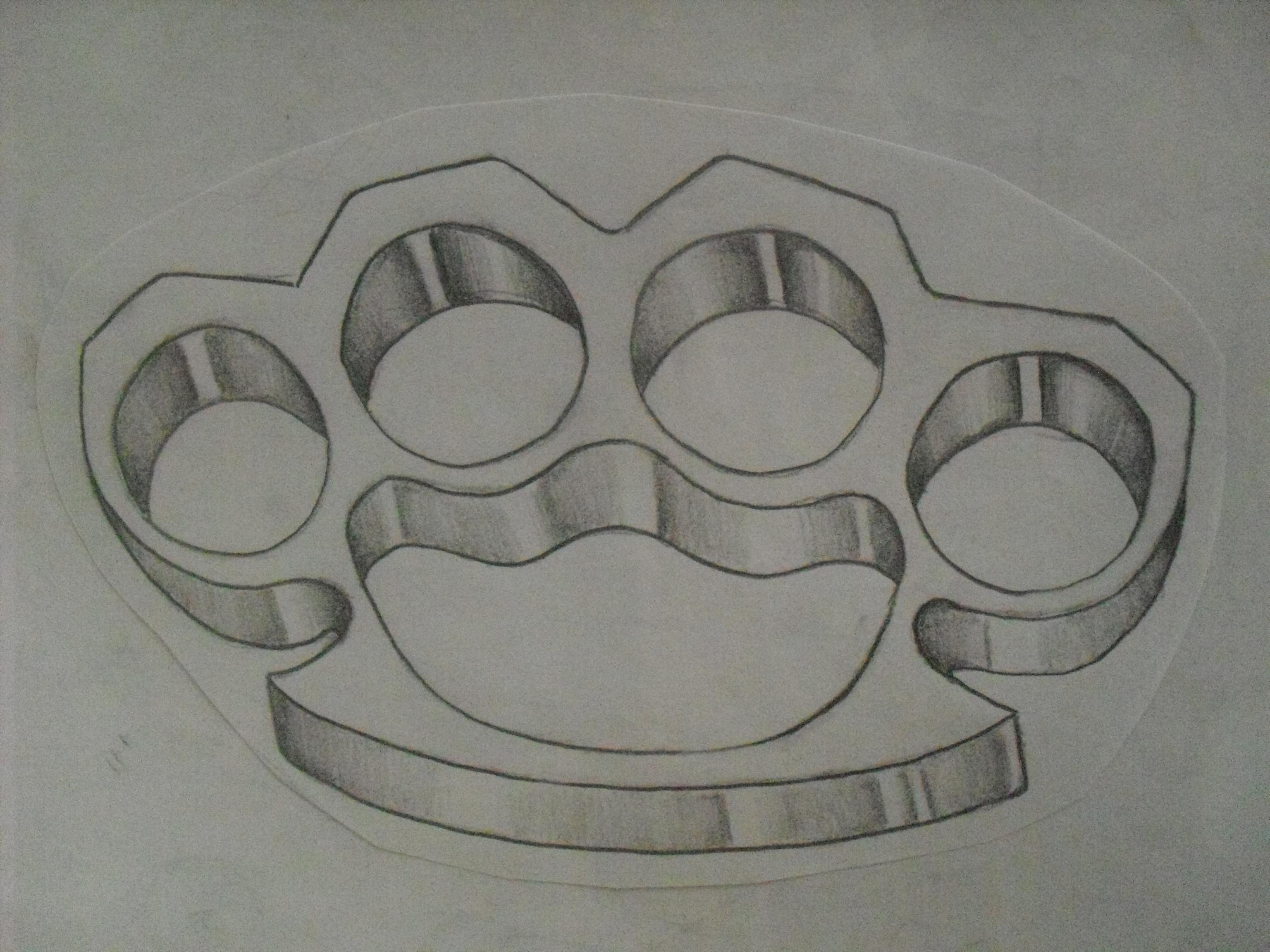 Brass Knuckle Tattoos