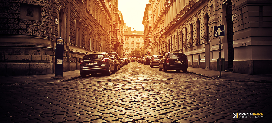 Downtown street in sunset by piximi