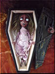 Zombie girl Mathania in coffin