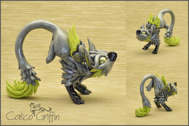 Silver running Griffin - polymer clay figurine by CalicoGriffin