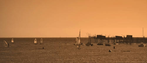 Sailboarding in early evening by macilvena