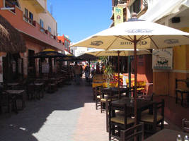 sidewalk cafe, isle of mujeres by bipolargenius
