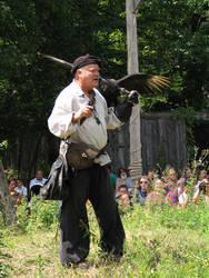 man with bird by bipolargenius