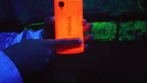The Red Nexus 5 under a blacklight.
