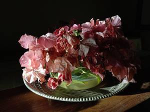 Dead flowers on a dusty table