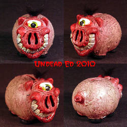Rot Cyclops Grin Piggy Bank by Undead-Art
