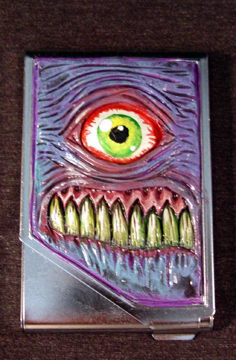 Cyclops Freak Cigarette Case by Undead-Art