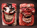 Evil Jester and jaw Rot Zombie Zippos