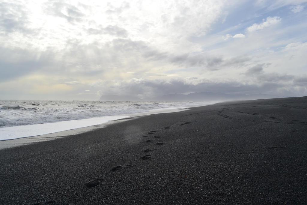 Walking on Black Beach by o0Christina0o