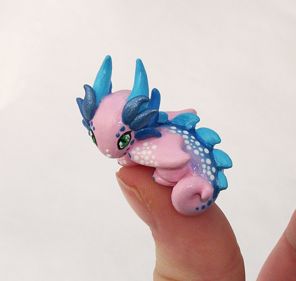 Rosey 'Thumb' Dragon by KingMelissa