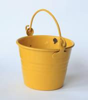 yellow bucket handle up by doko-stock