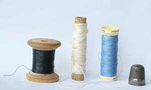 sewing threads and a thimble