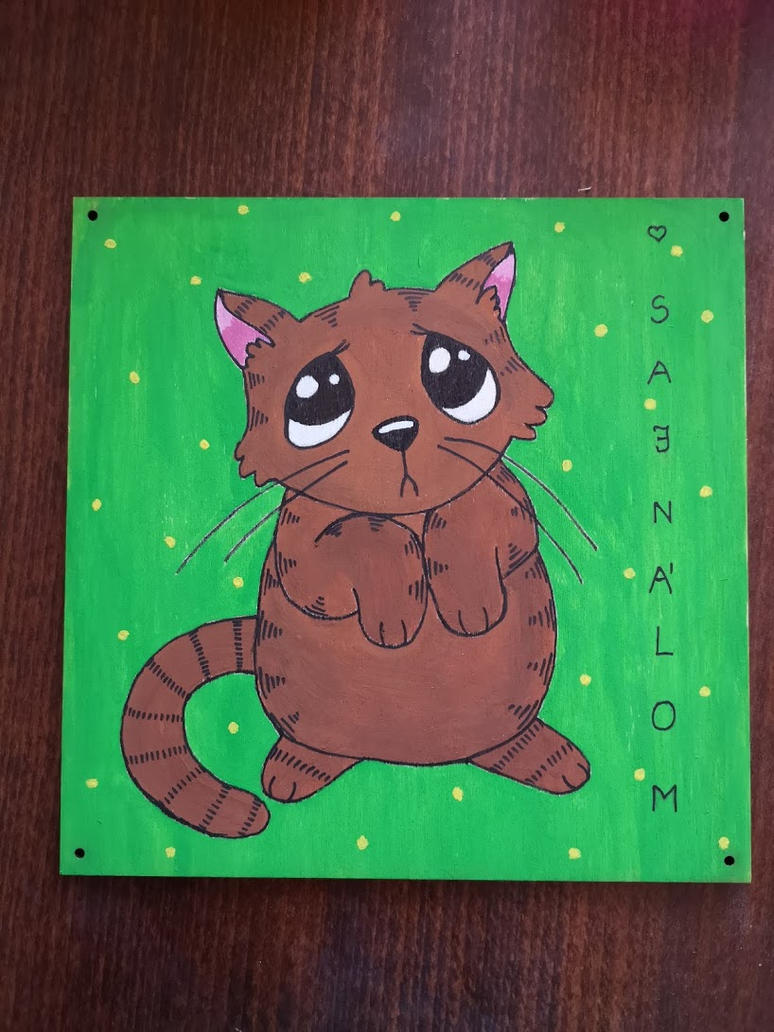 Sorrycat on wood