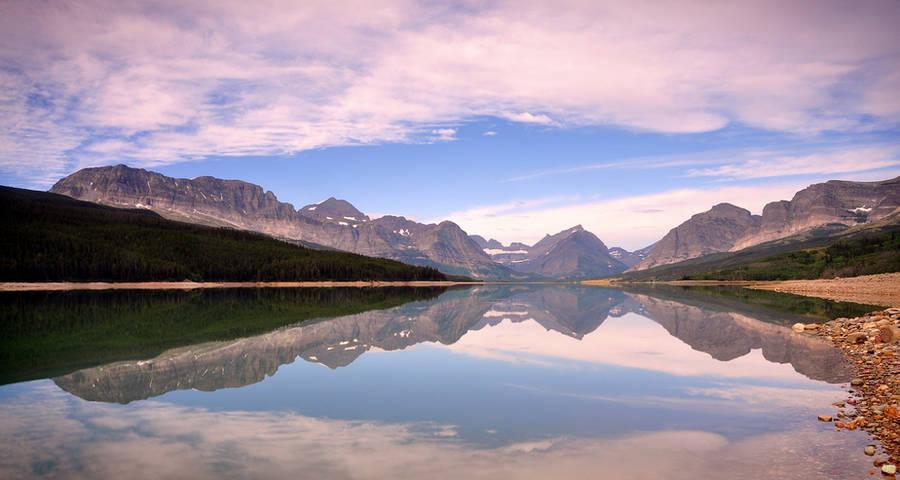 Lake Sherburne reflection by greglief