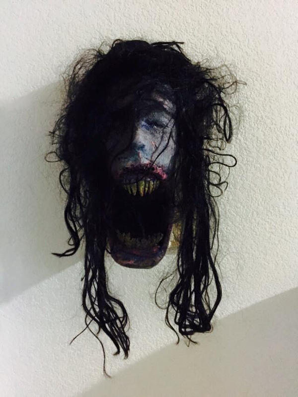 creepy face wall decor by UglyBabyEater
