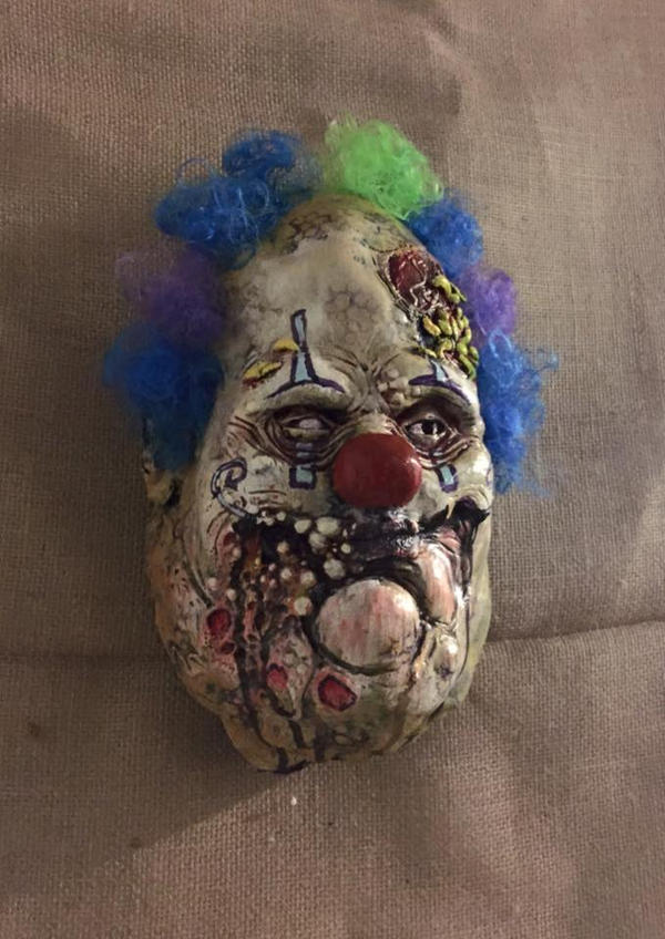 pleasant clown wall decor by UglyBabyEater