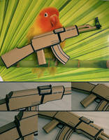 AK47 and bird on wall by receter